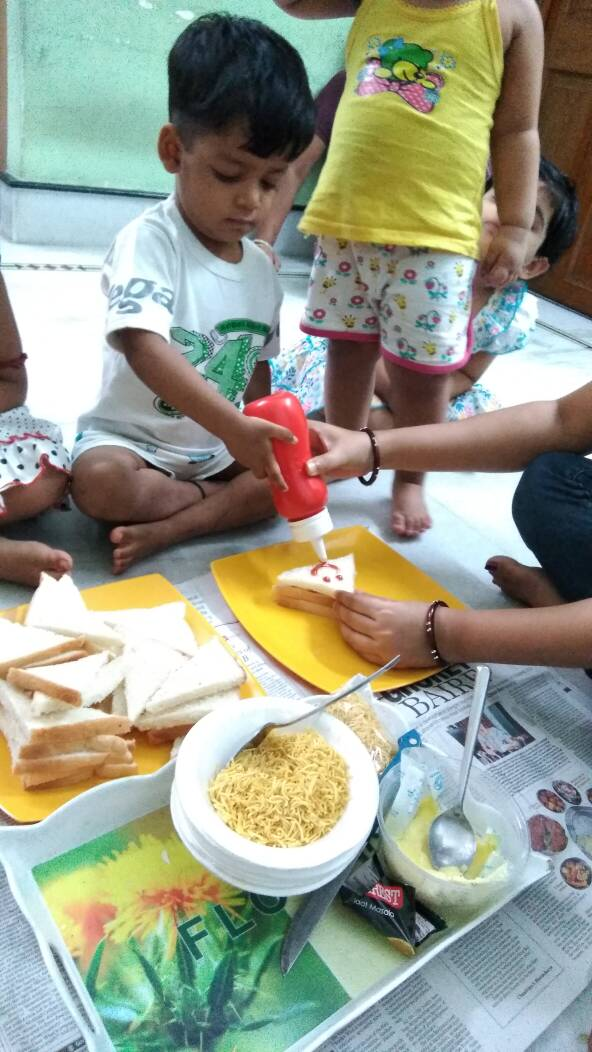 Non gas cooking and drawing activity by little one's in on going  summer camp.